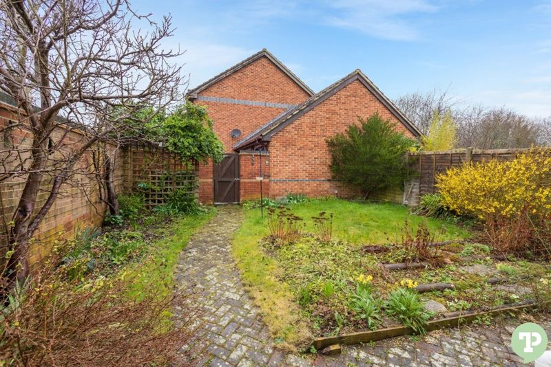 Rear garden showing gated access to driveway and g