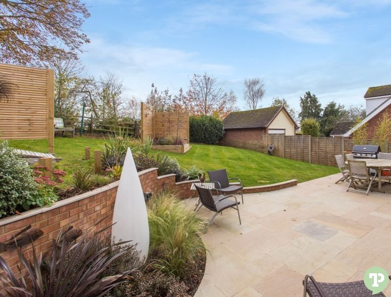 Landscaped rear garden with patio area