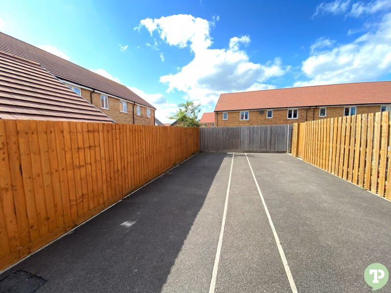 Tandem driveway to side of property with access to