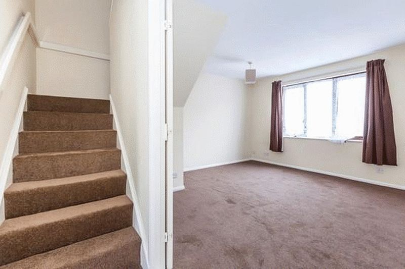 Stairs to second floor and bedroom one